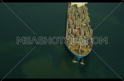 Arial shot for Cargo Ship sailing in Suez Canal at day