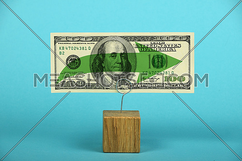 Stagnation and support of American economy and US dollar, one dollar banknote with green horizontal arrow on holder over blue background