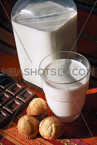 Breakfast ingredients, with milk, muffins and chocolate