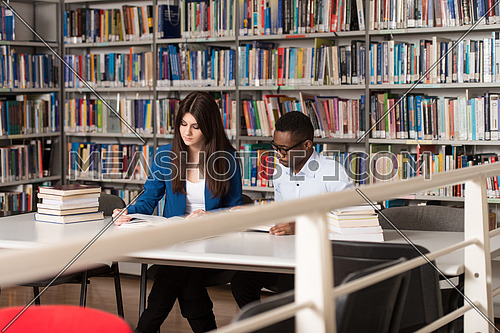 Sleeping Student Sitting And Leaning On Pile Of Books In College - Shallow Depth Of Field