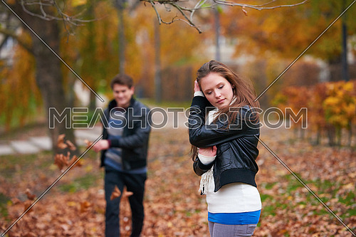 romantic young couple have fun in city park at autumn season