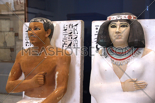 a photo from the Egyptian museum in Cairo showing a display of monumental pharaohs statues belonging to ancient Egyptian civilization