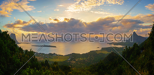 View from Piton de la Petite Riviere Noire, highest peak of Mauritius. Panorama at sunset.Le Morn Brabant on background.