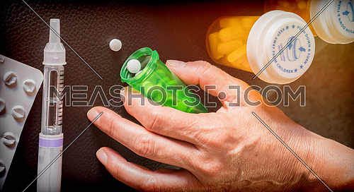 Woman examining treatment of insulin, conceptual image