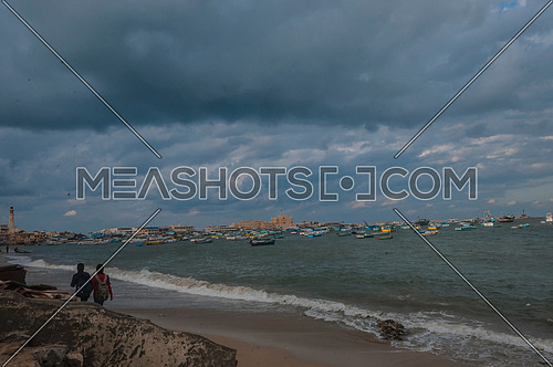 Long Shot for sea shore showing fishing boats and street at alexandria at day