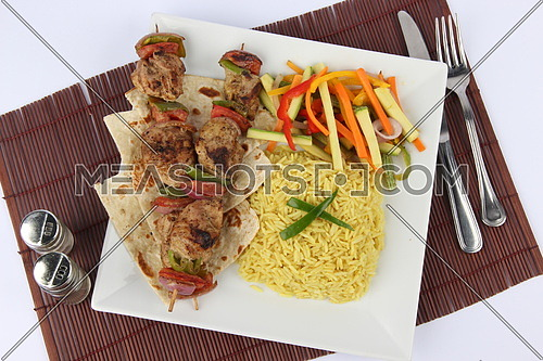a photo for a grilled meat dish with rice & steamed vegetables