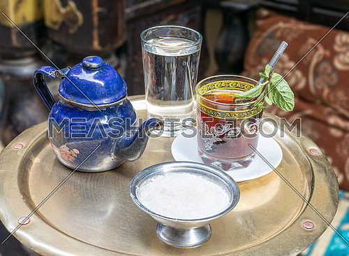 Traditional mint tea set on copper table in an oriental cafe at Khan El Kalili Bazar, Cairo, Egypt