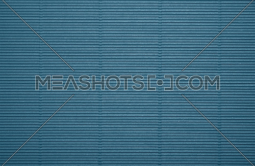 Close up background pattern texture of pastel blue corrugated packaging cardboard