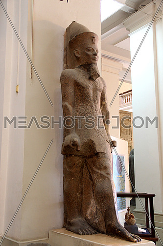 a photo from inside the Egyptian museum showing a display for ancient statues belonging to the pharaohs civilization