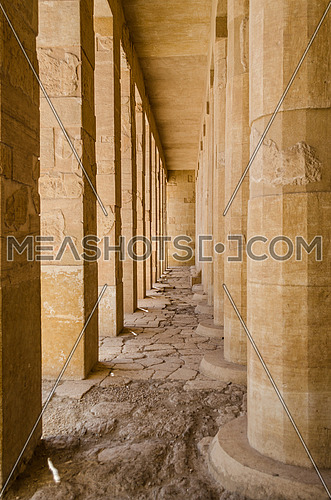 Huge old columns in a pharaoh temple at Deir El-Bahri Temple