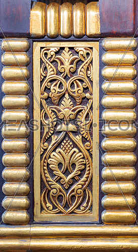 Wooden panel decorated with engraved floral patterns located at the public Mosque of historical Manial Palace of Prince Mohammed Ali, Cairo, Egypt