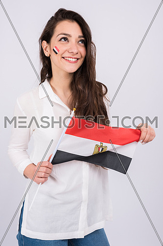 young lady holding egyptian fag in her hands and paint a small flag on her face