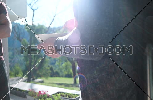 Happy Couple Drinking Coffee and eating breakfast on terrace of villa