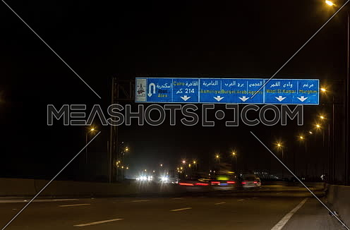 Track Left shot for Cars moving at Cairo-Alexandria Desert Road at Night