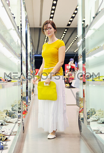 happy young woman shopping in big modern city mall