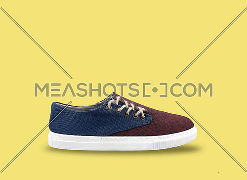 men shoes in yellow background