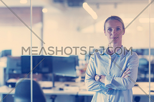 portrait of casual business woman at her modern start up business office interior