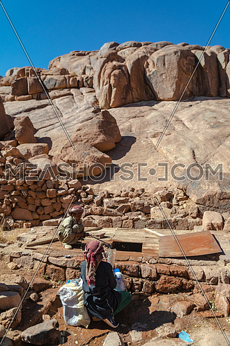 Long shot for bedouins get water from Ain Hudra at Sinai Mountain by day.