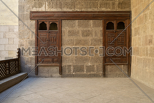 Stone brick wall with two embedded ornamented wooden cupboards at the terrace of Zeinab Khatoun house, a historic house in Old Cairo, Egypt