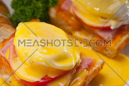fresh eggs benedict on bread with tomato and ham