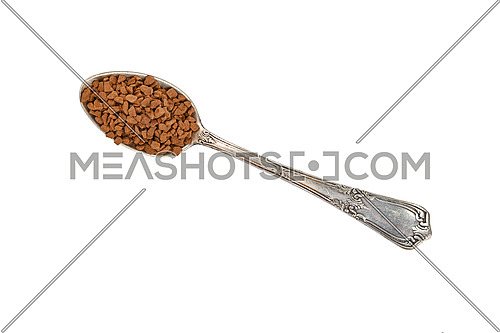 Close up metal spoon full of freeze dried instant coffee granules isolated on white background, elevated top view, directly above