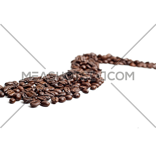 bounch of roasted coffee beans mimic a road shape