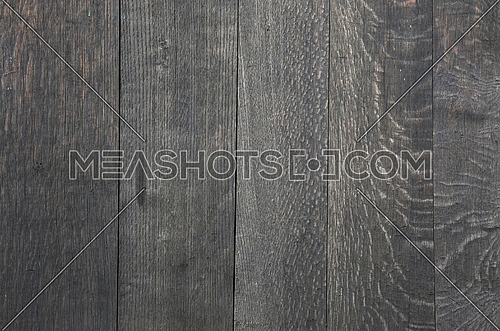 Old vintage aged grunge uneven gray faded wooden vertical planks texture background