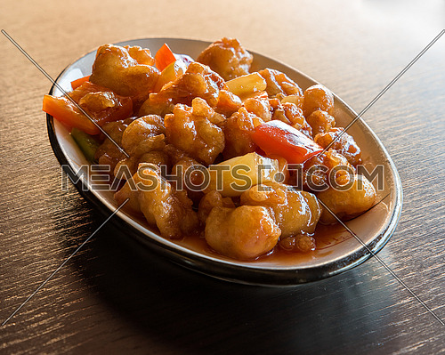 Chinese food, fried chicken stir with peppers and pineapple  in sweet source