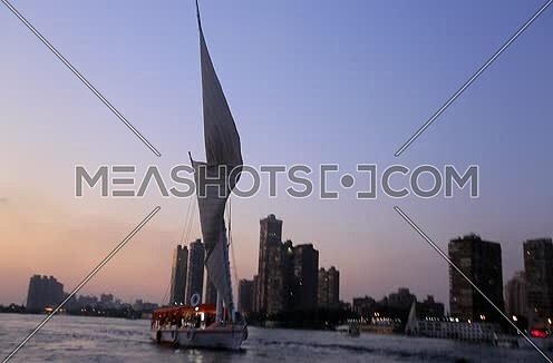 Long shot for the River Nile and a feluka at sunset in Cairo