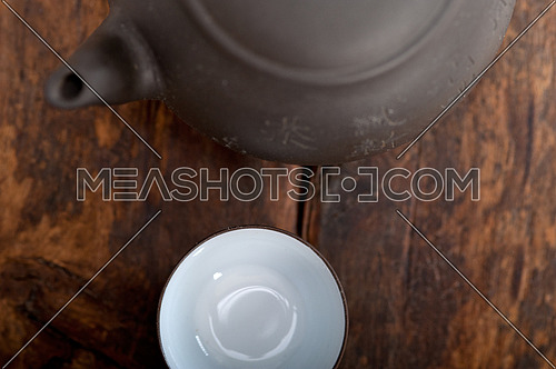 chinese style pot and cups over old wood table