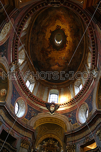Low angle view of beautiful cupola with fresco of historic baroque church of Saintt Peter in Vienna, Austria