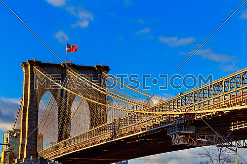 American flag on Brooklyn Bridge Brooklyn bridge with cloudy blue sky, New York