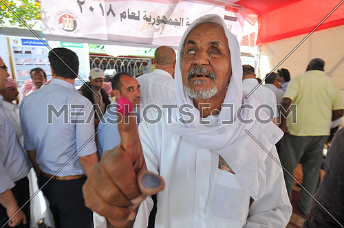 old egyption blind man after voting in the 2018 Egyptian presidential elections in the peace city of Sharm El-Sheikh in South Sinai on the first day of the elections 26 March 2018, which lasts for 3 days