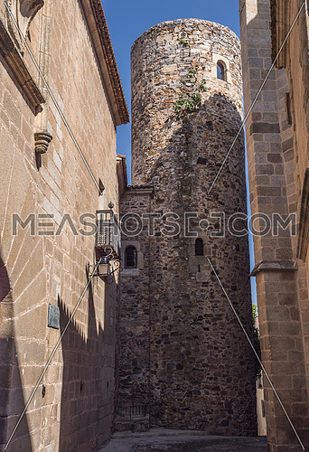 "Caceres, Spain - july 13, 2018: House and Tower of Carvajal of Arab origin, of Civil architecture and Medieval epoch, known like ""The Burnt House"", due to a fire that took place in the nineteenth century., Caceres, Spain"