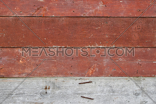 Red vintage aged painted wooden panel with horizontal planks texture background with one unpainted raw plank