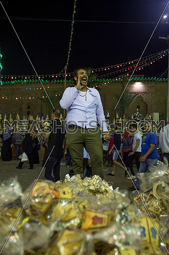 Male Street Seller sells The lanterns of the holy month of Ramadan.