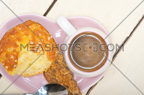 coffee and muffin served on a pink heart shaped dish