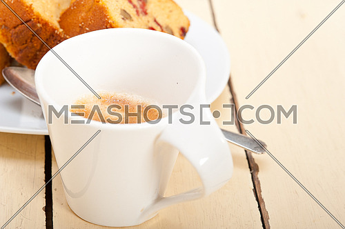 plum cake and espresso coffee over a white rustic table