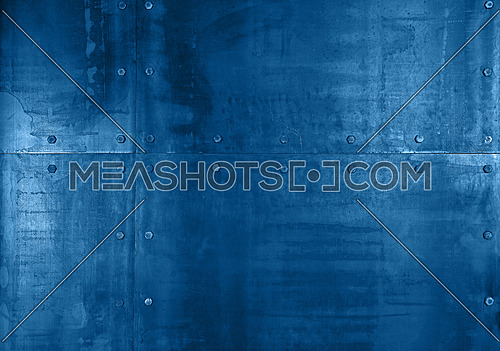 Background texture of grunge blue toned steel metal panels wall with rivets or bolts