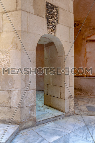 Aged narrow vaulted passage and stone bricks wall, Medieval Cairo, Egypt