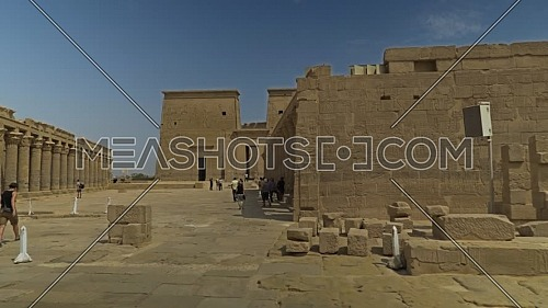 Reveal shot for the main entrance of Temple of Phila and tourists at Aswan - Egypt by day