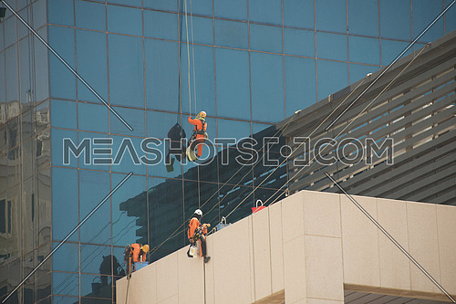 window cleaners on high skyscraper in dubai