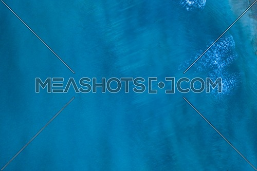 Blue surface of sea water, shot in the open sea directly from above