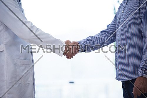 doctor and patient hand shaking