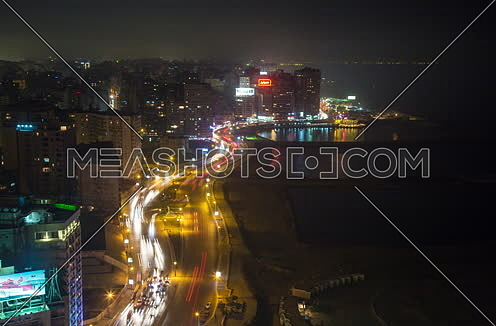 Fixed Shot for traffic in Korneish at Alexandria at night