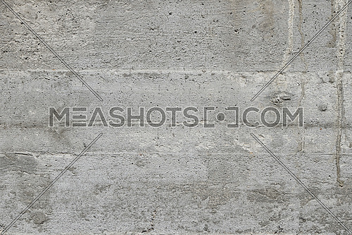 Grunge uneven grey concrete surface background texture with layers of wooden casing