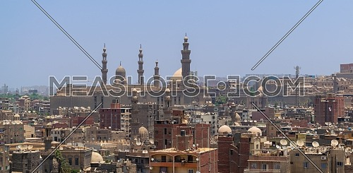 Aerial cityscape view of old Cairo, Egypt with Old grunge buildings and Sultan Hasan Mosque in far distance
