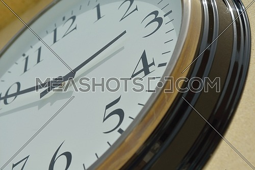 classic vintage wall clock on yellow background