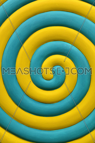 Close up abstract multicolor background of yellow and teal blue spiral