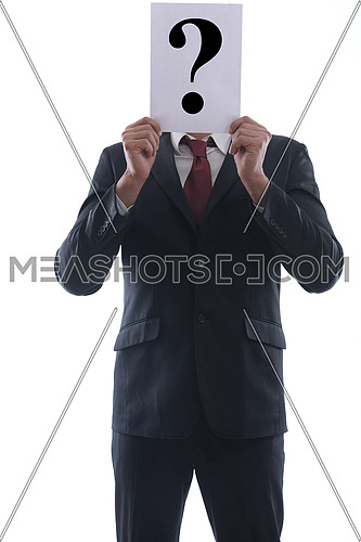 Business man holding a piece of paper over his face with a question mark on it isolated on white background in studio